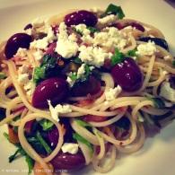 Spaghetti aglio e olio with kalamatas https://naturalhealthconsciousliving.com/2015/01/17/spaghetti-aglio-e-olio-with-olives-gf/